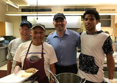 Community Meal Serving Team with Sen. Akshar